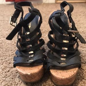Black and gold buckle up wedges